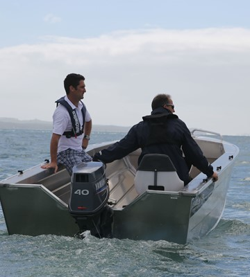 people with lifejackets in a boat