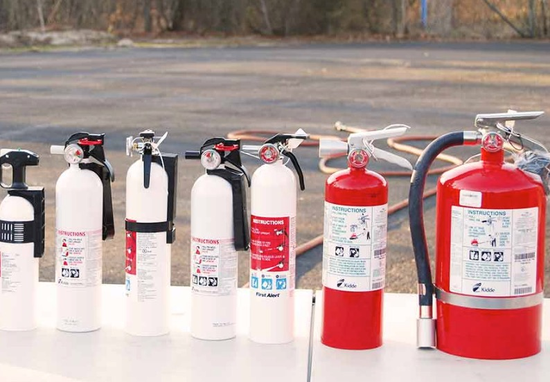 A range of fire extinguishers. Credit: BoatUS Foundation.